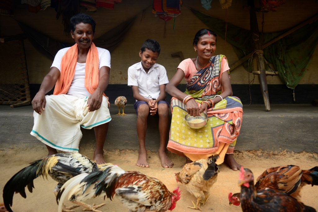 Koili Murmu, her husband and son in Heseldihi village, Mayurbhanj district, India